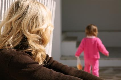 Toddler walking away from mom.