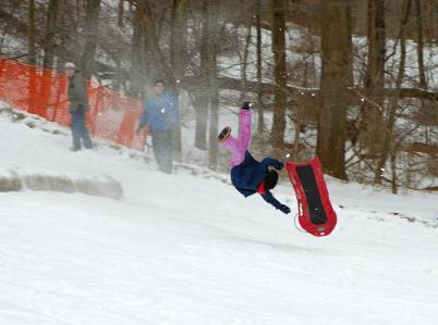 Mid-air sledding accident.