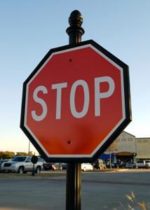 A stop sign in a Texas shopping center.