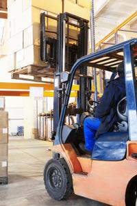 driver of a forklift loader at warehouse