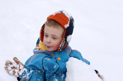 Preschooler playing in the snow