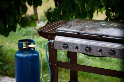 a propane tank and gas grill