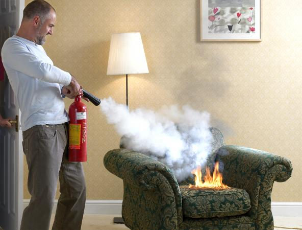 Man putting out upholstery fire