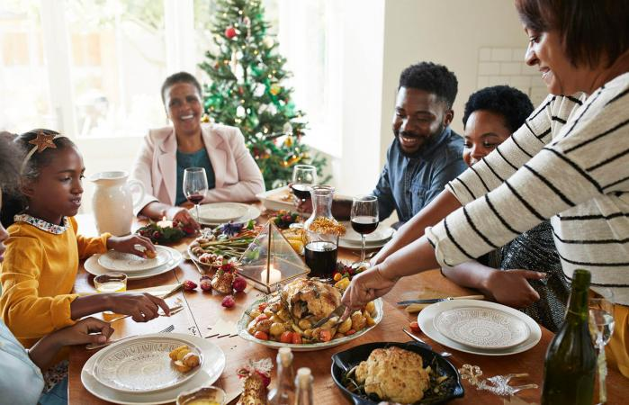 serving holiday food to family