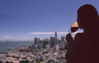 Woman with glass of wine on San Francisco city