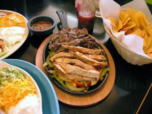 Fajita plate and tortilla chips at a Mexican restaurant