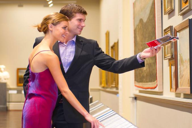 Couple looking at art in museum