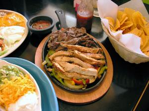 Fajita plate and tortilla chips at a Mexican restaurant