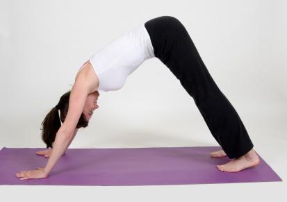 Woman practicing yoga at a studio
