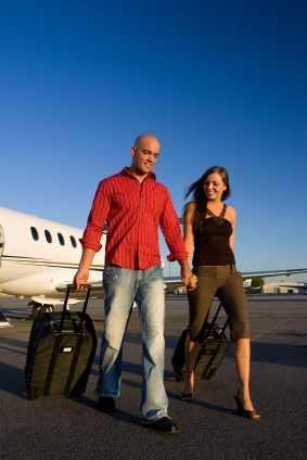 Couple deboarding a charter jet in San Francisco