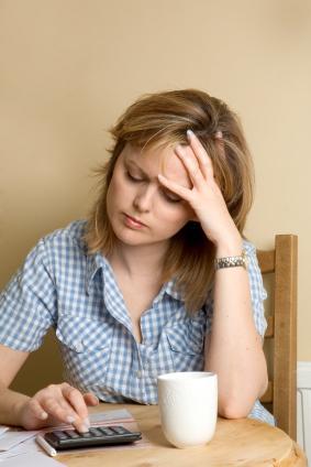 Woman Overwhelmed by Bills