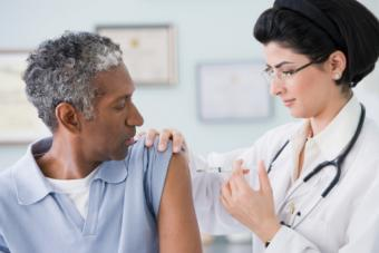 doctor giving shot to patient