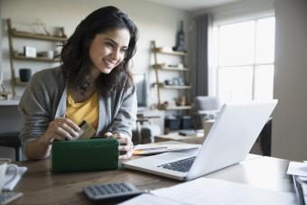 Image of woman shopping at a website
