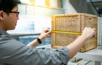 man measuring a box