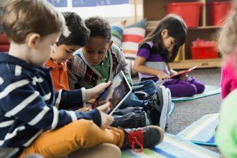 Kids looking at digital tablet