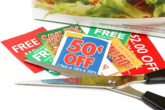 Scissors and coupons cut from ad