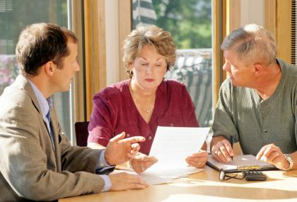 Couple meeting with a financial advisor