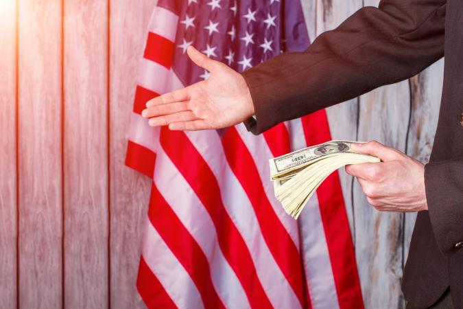 Businessman with money giving hand