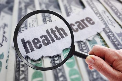 Magnifying glass looking at health care