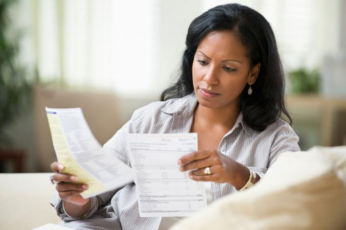 Woman reviewing cell phone bill