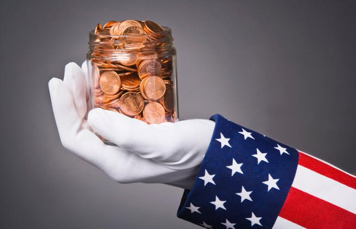 Uncle Sam holding a jar full of pennies