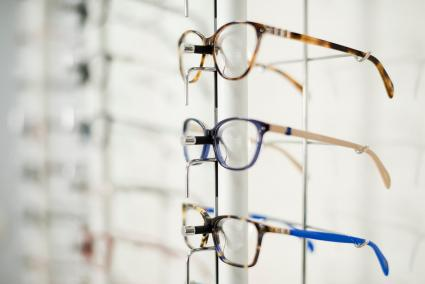 Eyeglass frames on a rack