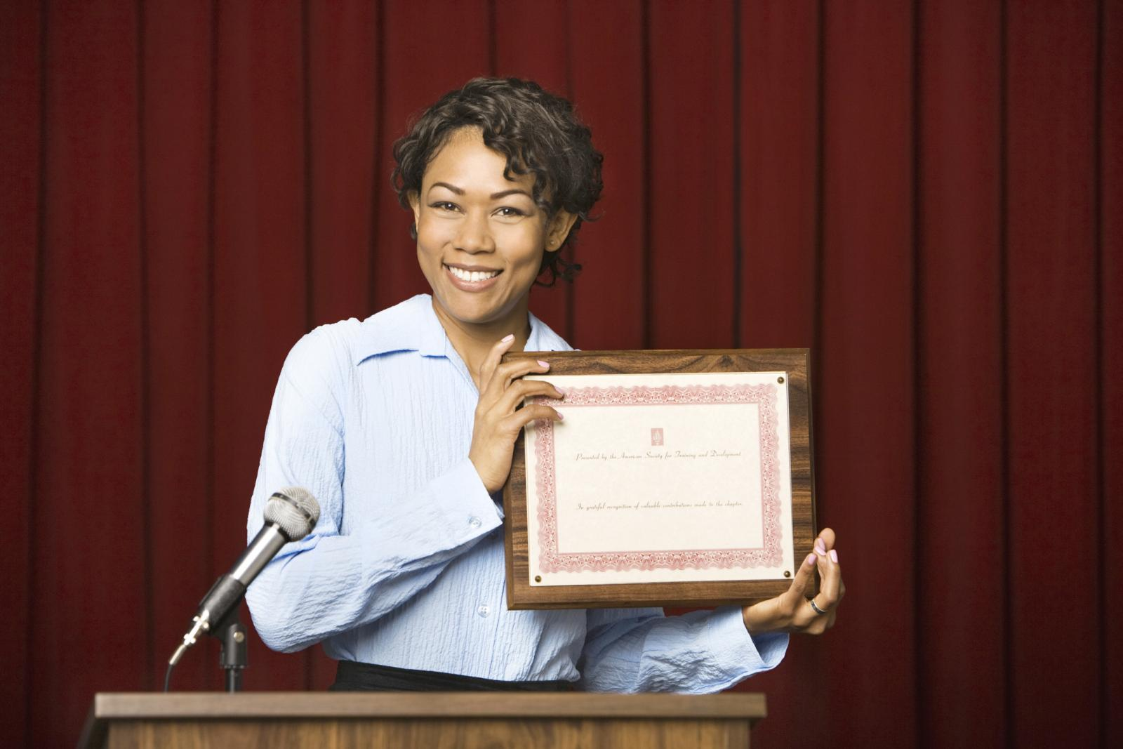 Worker being given an award certificate