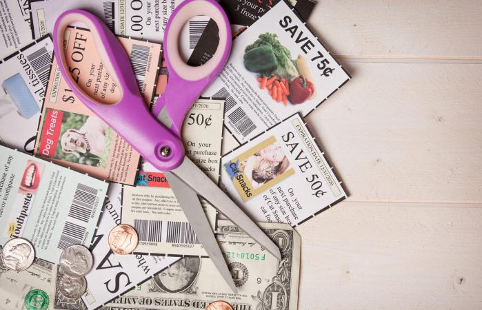 Coupons Pile With Scissors