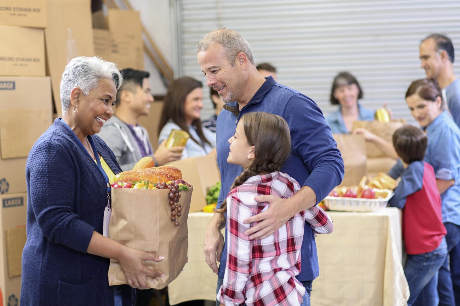 Group of volunteers work at food bank
