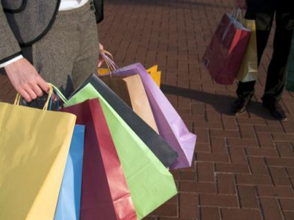 People carrying lots of shopping bags