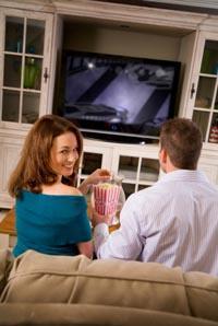 Couple enjoying their entertainment center