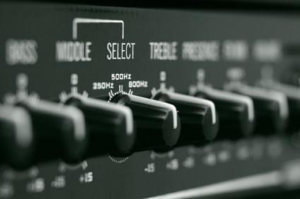 Closeup of a bass guitar amp's knobs