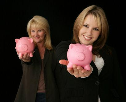 Two women with piggybanks