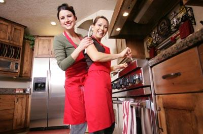 Two women cooking.