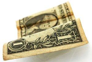 Image of a crumpled $1 bill