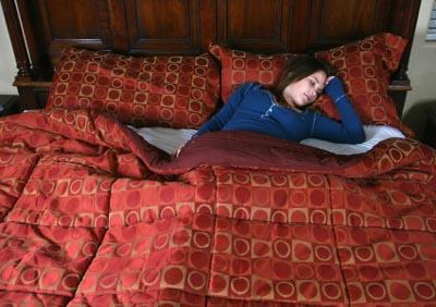 Woman resting on coordinated bedding