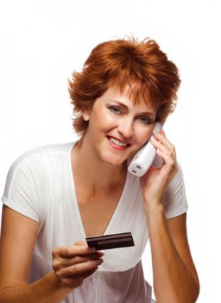 Woman using a phone card to make a call