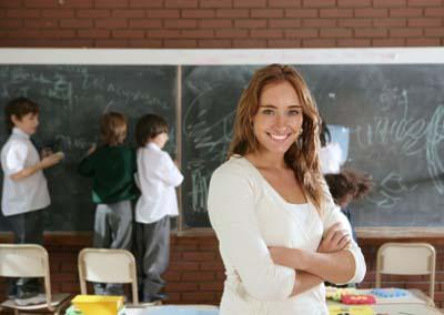 Female elementary teacher in classroom with students