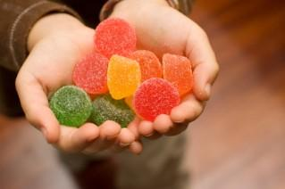 Child's hands holding sample of gum drop candies