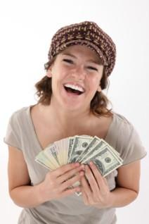 Laughing cheapskate showing off her money