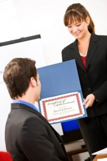 Office worker being given an award certificate