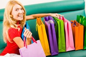Female shopper with gift bags and purchases