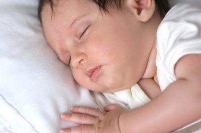 Image of a contented sleeping baby