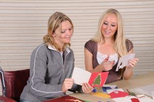 Two women making handcrafted cards