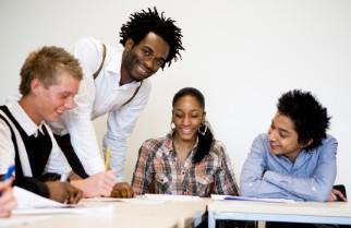 African American teacher working with students