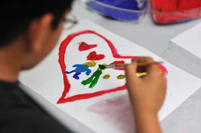 Child painting on paper