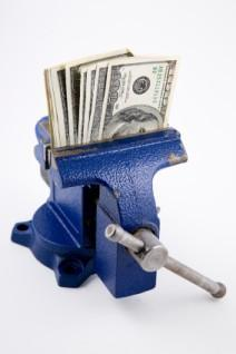 Image of money saved in a vice grip
