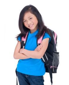 young girl in backpack