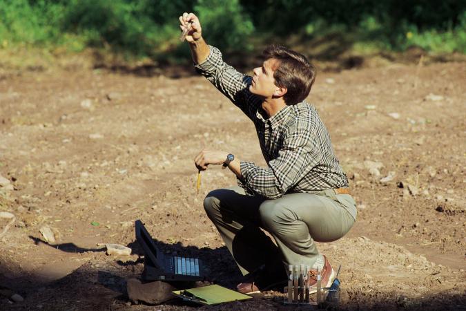A professional testing soil