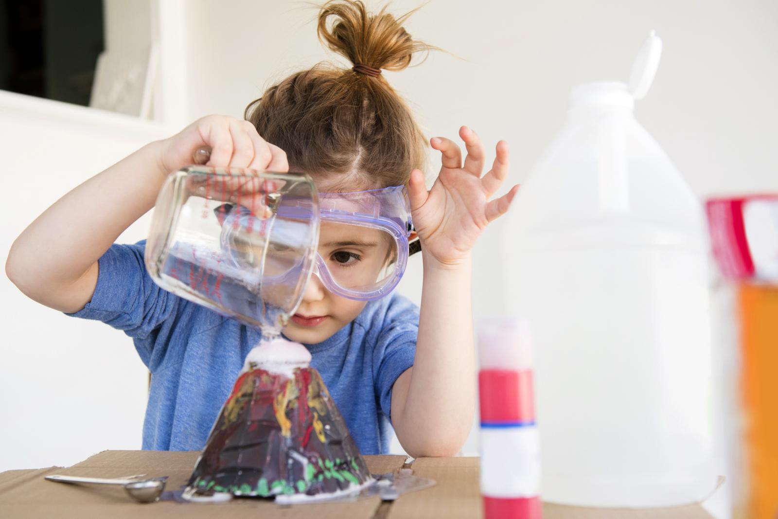 Girl making volcano